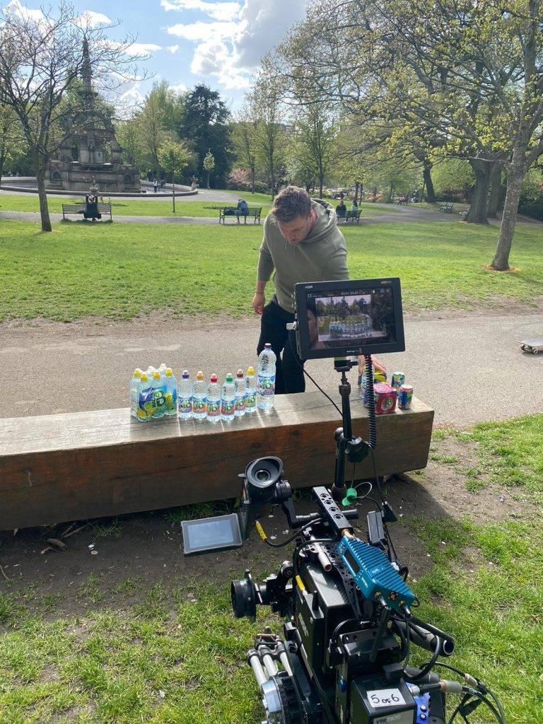 Man organising bottles behind the scenes