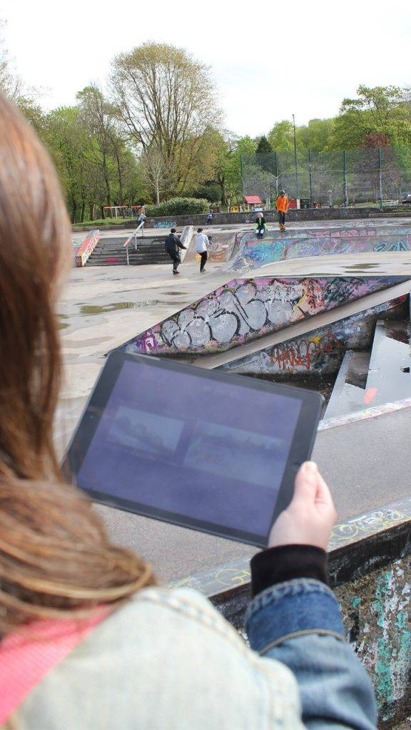 Woman looking at ipad behind the scenes tv ad filming